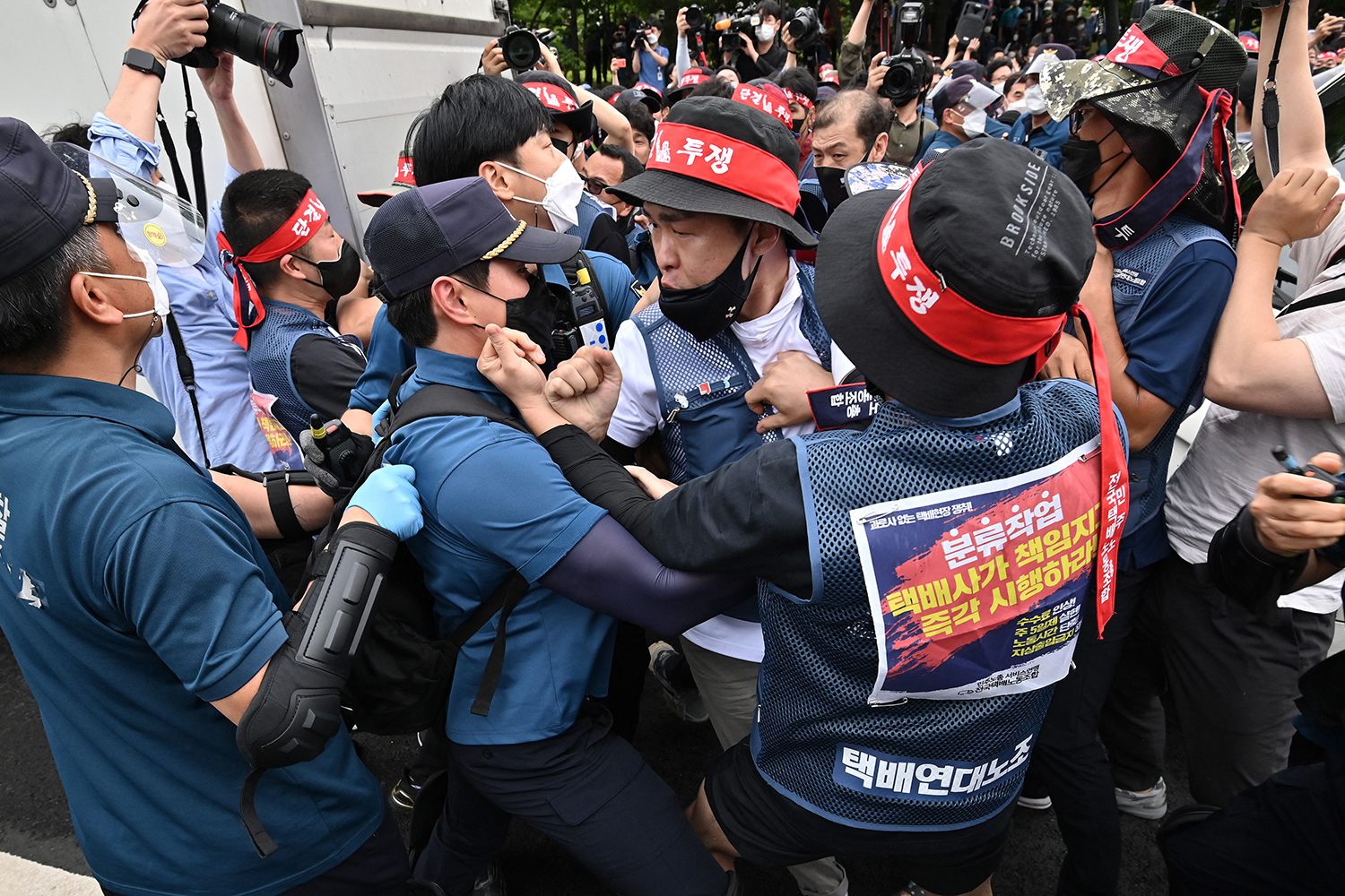 Workers scuffle with police in South Korea at demonstration