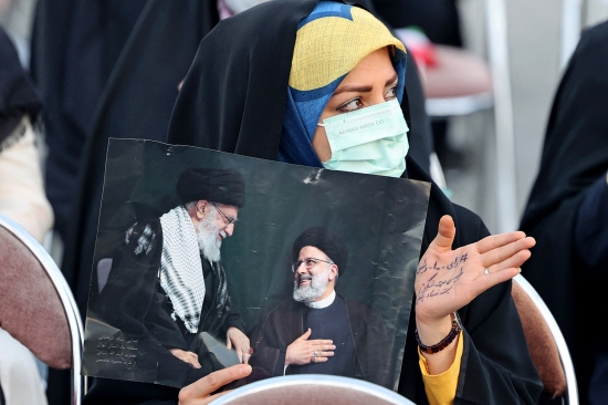 A supporter of Iranian presidential candidate Ebrahim Raisi