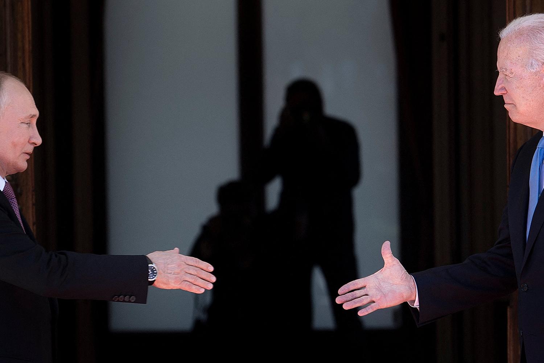 Vladimir Putin and Joe Biden shake hands