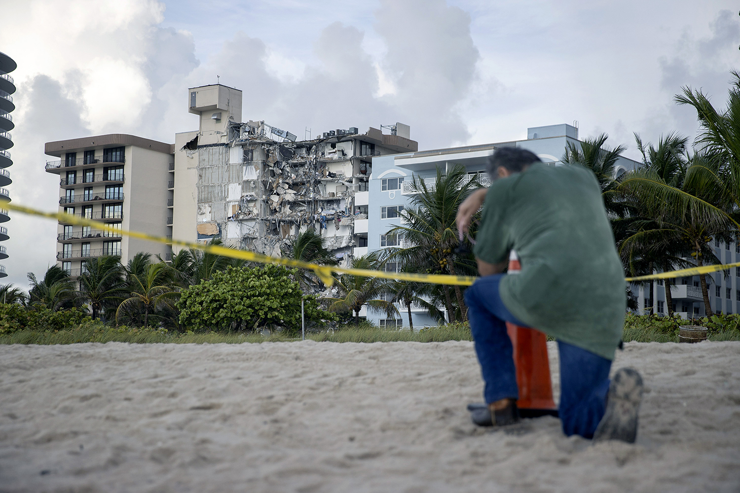A man prays at site of collapsed condo in Florida