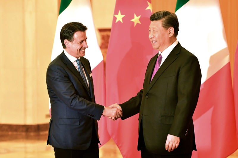 Then-Italian Prime Minister Giuseppe Conte shakes hands with Chinese President Xi Jinping