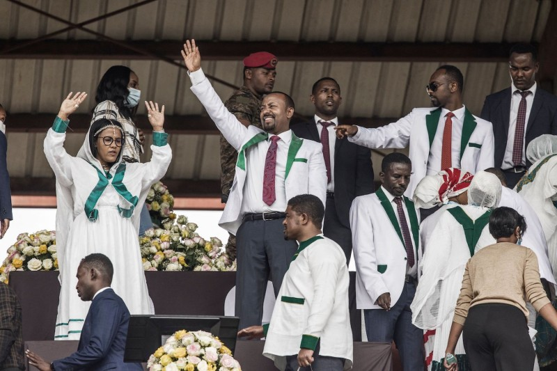 Ethiopian Prime Minister Abiy Ahmed acknowledges a crowd of supporters at a stadium in Jimma, Ethiopia.