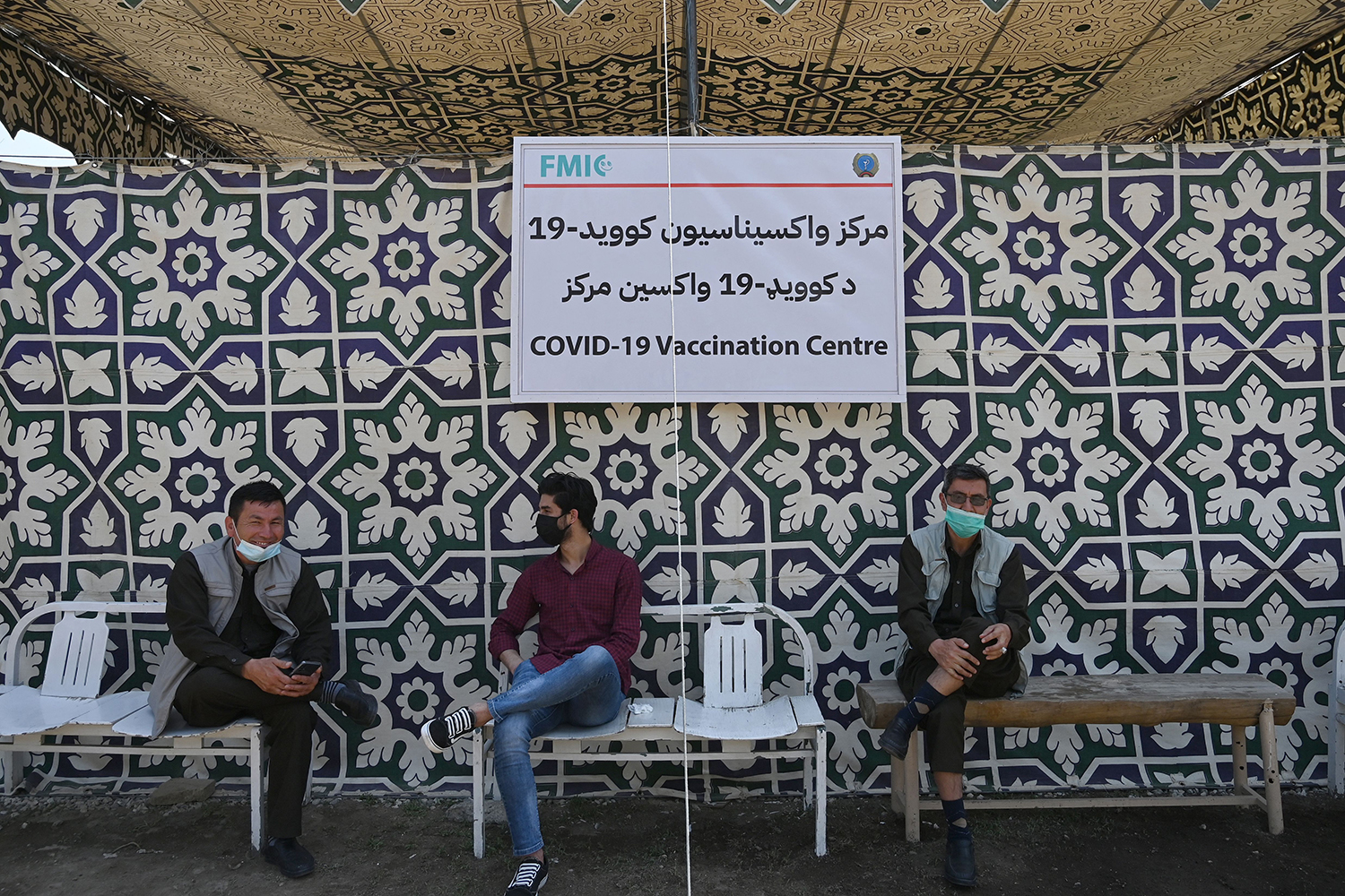 Men wait to receive the dose of Covishield vaccine against the Covid-19 coronavirus at a vaccination center in Kabul on April 26.