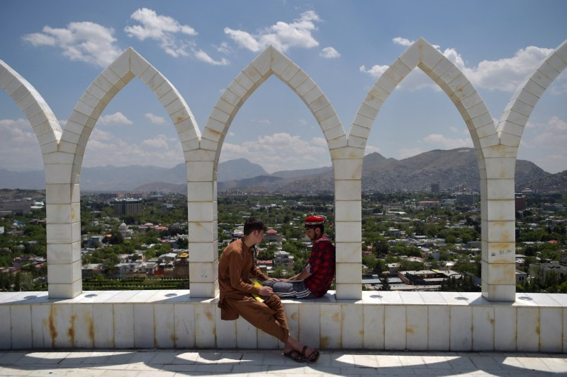 Young people sit at the Wazir Akbar Khan hilltop during a national day of mourning in Kabul on May 11.