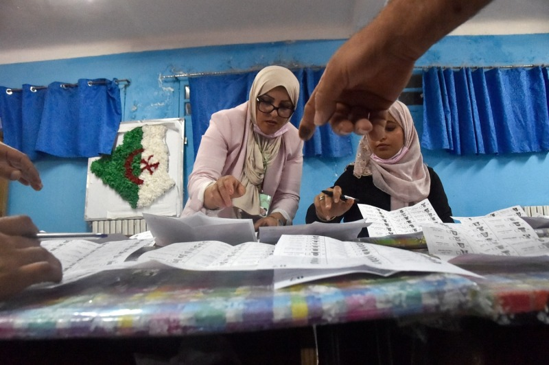 Algerian elections staff count ballots for parliamentary elections at a polling station in Bouchaoui, Algeria, on June 12.
