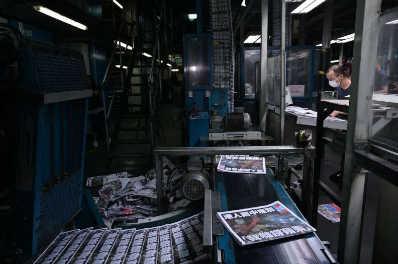 Apple Daily employees work in the printing room on the last edition of the newspaper, in Hong Kong on June 24.