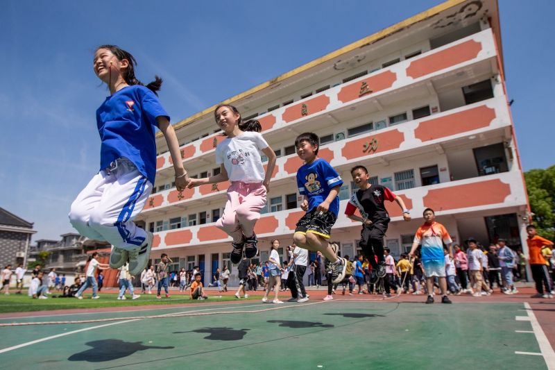 Elementary school students play on International Children's Day in Haian, China, on June 1.