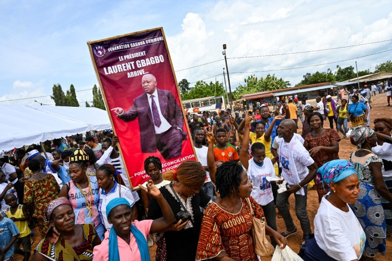 Supporters of the Ivorian Popular Front rally before the reception of former Ivory Coast President Laurent Gbagbo in his hometown of Mama, Ivory Coast, on June 13.