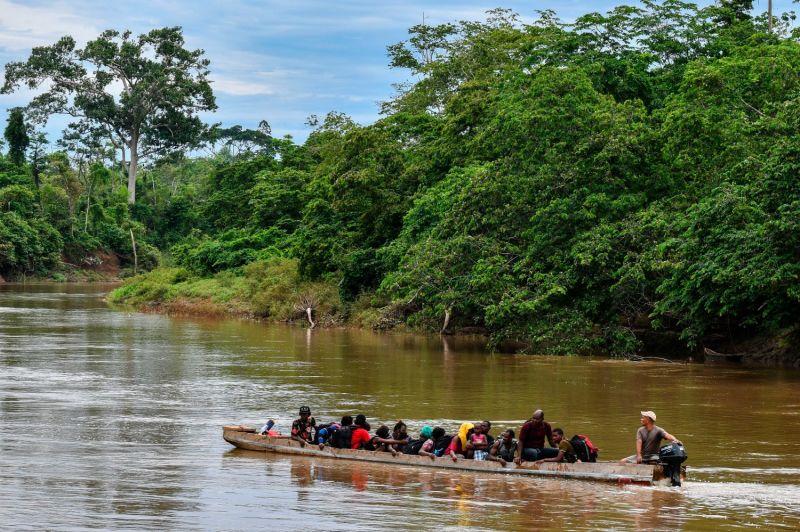 Haitian migrants cross the Chucunaque River by boat to La Penita village, Darién province, Panama, on May 23, 2019.