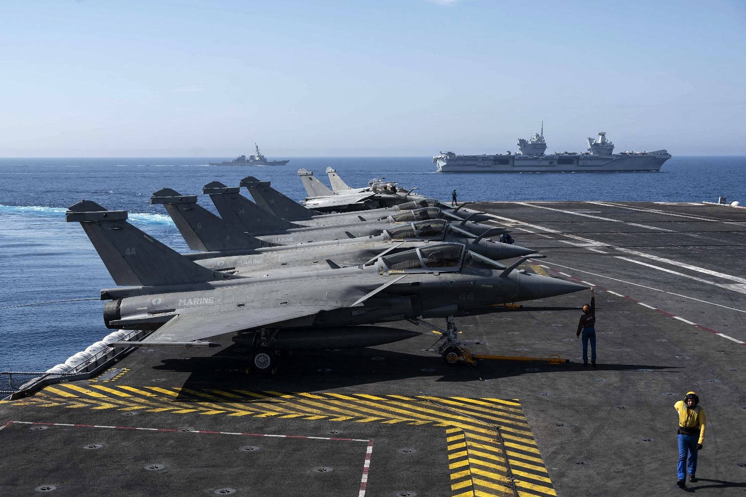 French navy Rafale jet fighters sit near the French coast.
