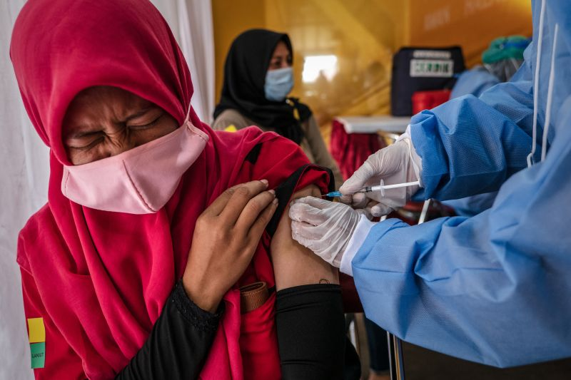 Woman receives Sinovac vaccine in Indonesia