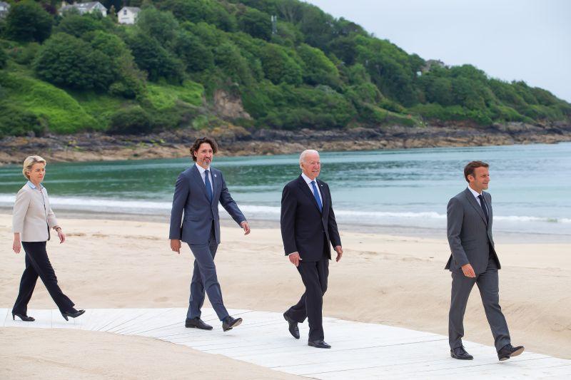 European Commission President Ursula von der Leyen, Canadian Prime Minister Justin Trudeau, U.S. President Joe Biden, and French President Emmanuel Macron during the G-7 Summit in Cornwall, England, on June 11.