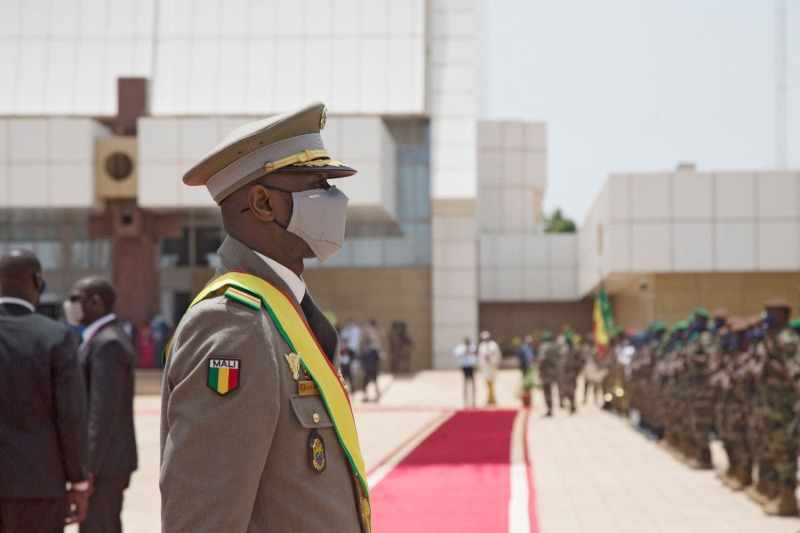 New interim Malian President Assimi Goita looks at members of the Malian Armed Forces after his swearing-in ceremony in Bamako on June 7.