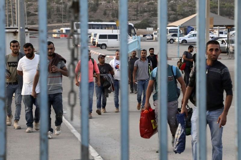 Palestinian workers cross into Israel to reach their jobs at Tarkumiya checkpoint near Kiryat Gat, Israel, on Nov. 14, 2019.