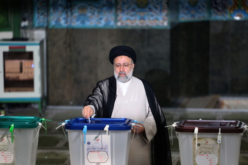 Iranian presidential candidate Ebrahim Raisi casts his ballot.