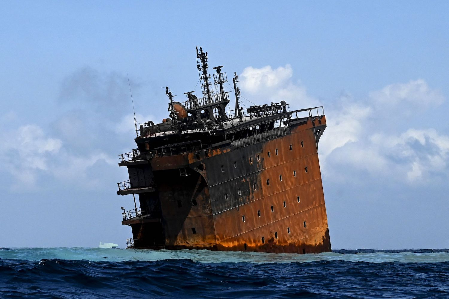 Singapore-registered container ship <em>MV X-Press Pearl</em> sinks after burning for almost two weeks, just outside the harbor of Colombo, Sri Lanka, on June 2.