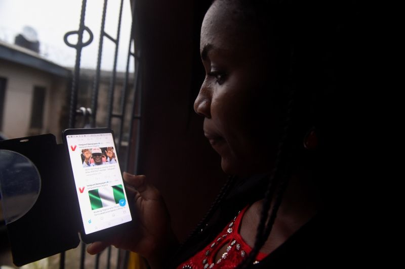 A woman looks at Twitter on her smartphone in Lagos, Nigeria, on Oct. 29, 2018.