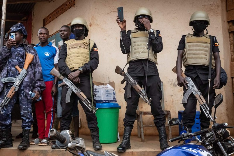 Security officers record Bobi Wine.