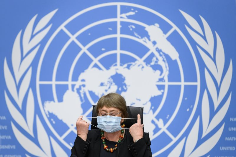 U.N. High Commissioner for Human Rights Michelle Bachelet removes her face mask before a press conference at the United Nations in Geneva on Dec. 9, 2020.