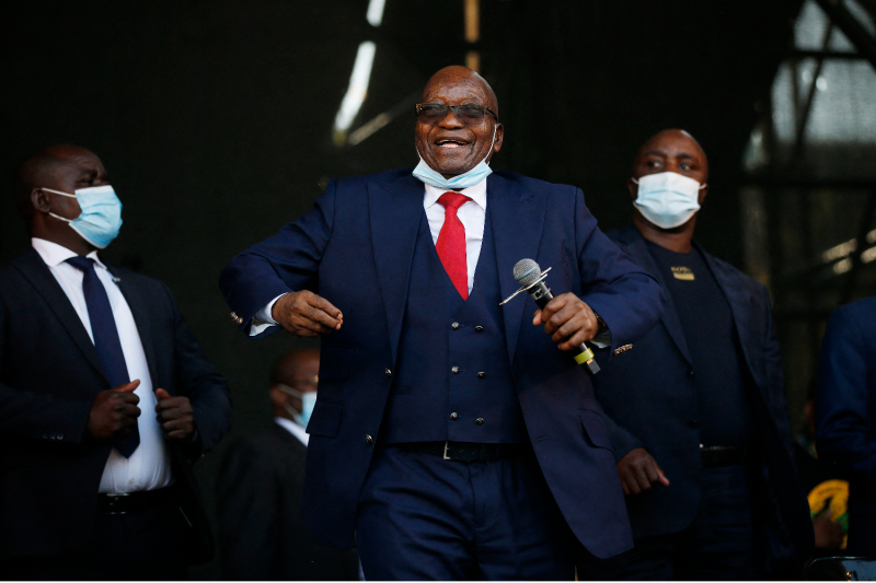 Former South African President Jacob Zuma dances onstage before addressing his supporters following the postponement of his corruption trial outside the Pietermaritzburg High Court in Pietermaritzburg, South Africa, on May 26.