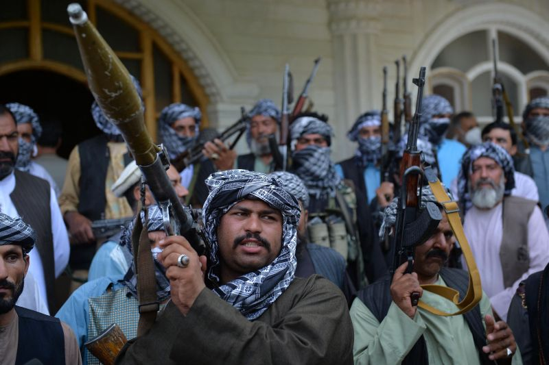 Afghan militia gather with their weapons to support Afghanistan security forces.