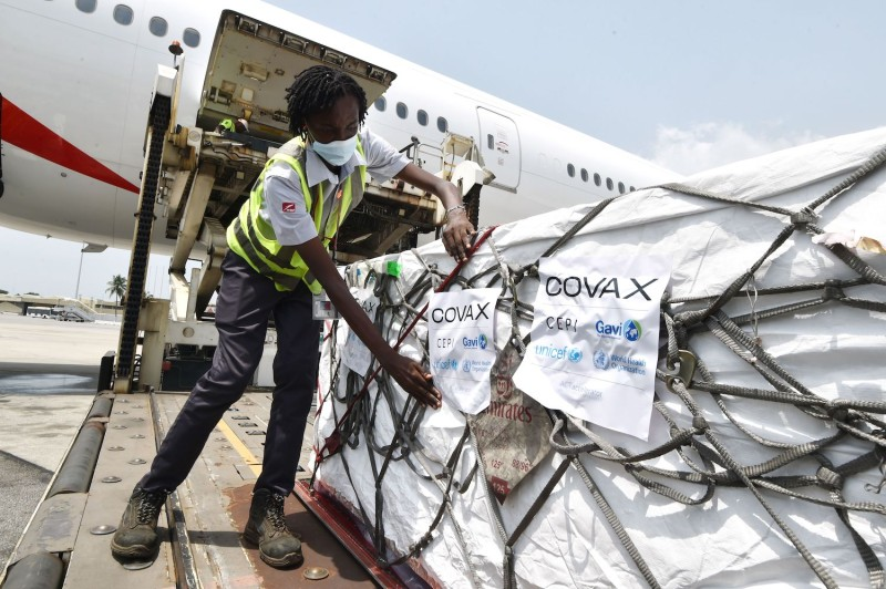 Workers unload vaccine shipments in Cote d'Ivoire.