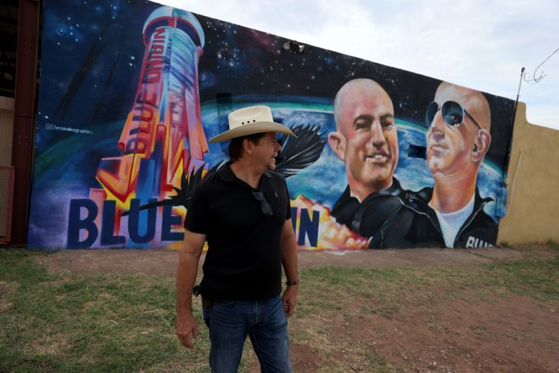 David Morales stands near a mural on the side of his building he had painted to honor Jeff Bezos as the billionaire plans to launch his Blue Origin rocket from a launchpad in West Texas in Van Horn, Texas, on July 19.