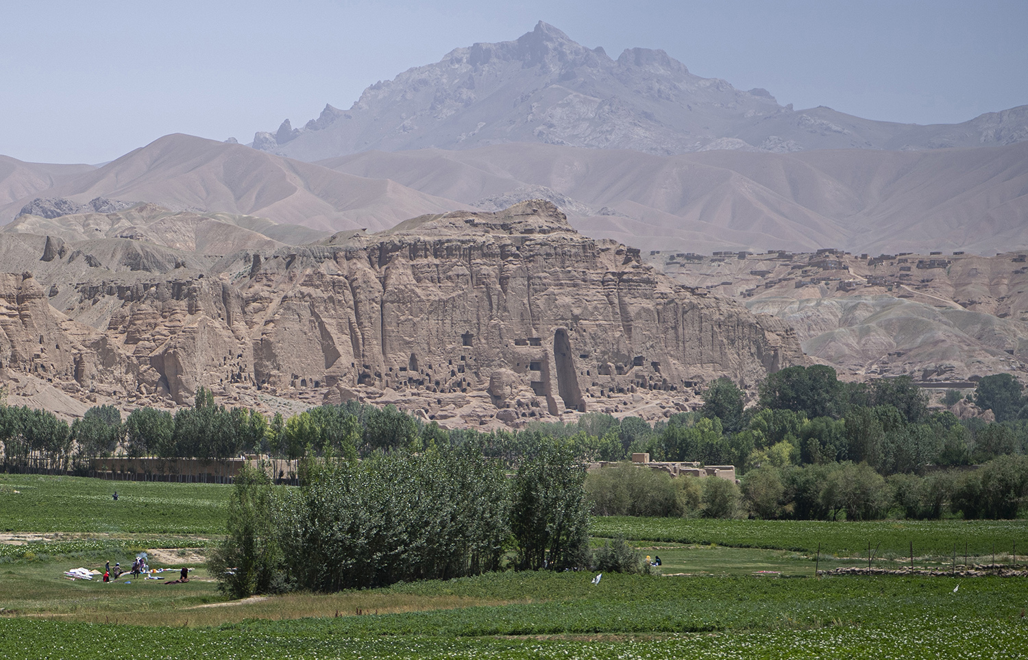 Hazara tribal women wash their clothes in Bamiyan city on July 18 in a river close to the site where 6th-century Buddha statues were destroyed by the Taliban in March 2001.