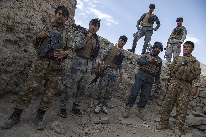 Bamiyan police pose at their post atop a hill in Ghandak village of Shebar district in Bamiyan on July 18.