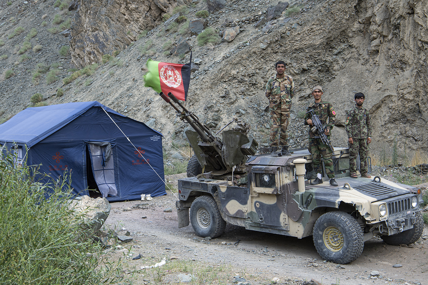 Soldiers pose for a picture in Du Ab village of Shebar district in Bamiyan province, Afghanistan, on July 18.