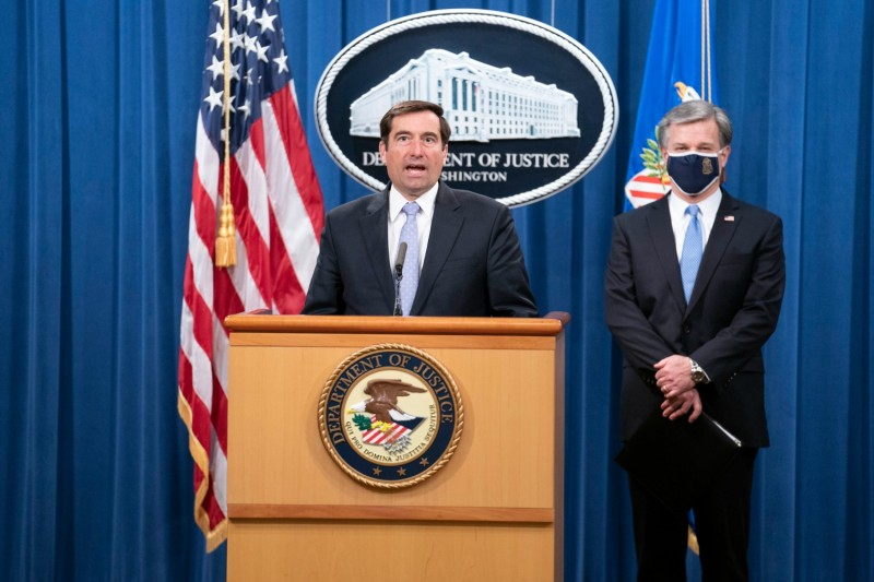 John Demers (left), the U.S. assistant attorney general for national security, and FBI Director Christopher Wray participate in a virtual news conference at the U.S. Justice Department in Washington on Oct. 28, 2020.