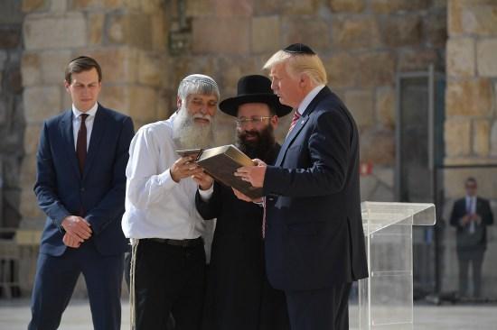 U.S. President Donald Trump listens to Rabbi Shmuel Rabinowitz at the Western Wall in Jerusalem.