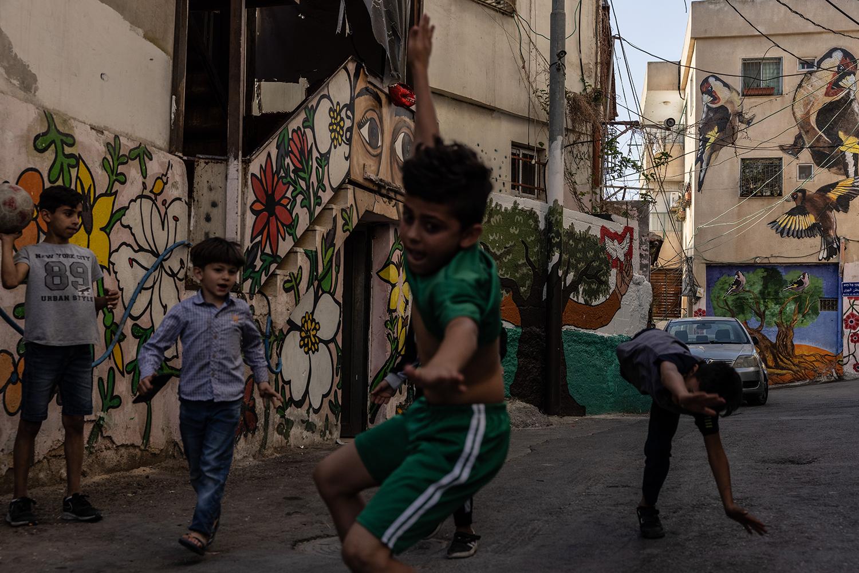 Children play in East Jerusalem's Batan al-Hawa neighborhood on June 11.