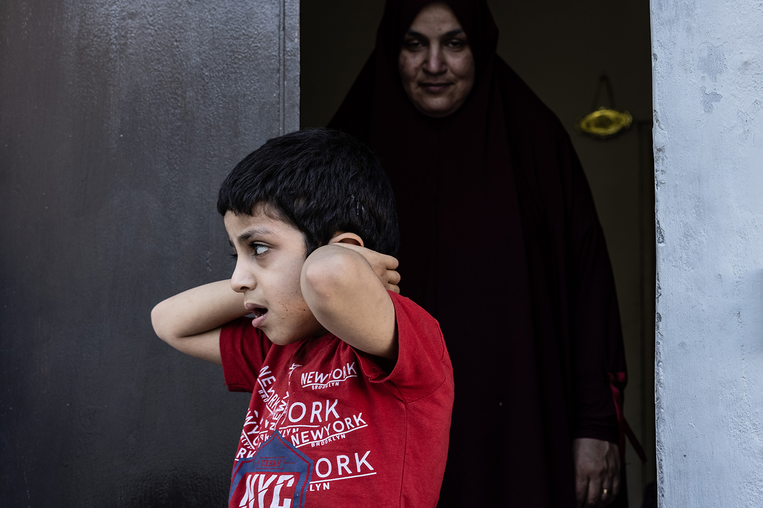 Eight-year-old Mohammed in Al-Bustan on June 14. Almost daily escalations have scared the boy, who has autism—he rarely ventures outside his home.