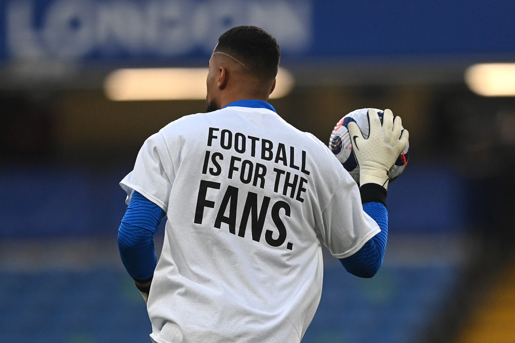 """Soccer player Robert Sanchez wears a protest T-shirt """"Football is for the fans"""""""
