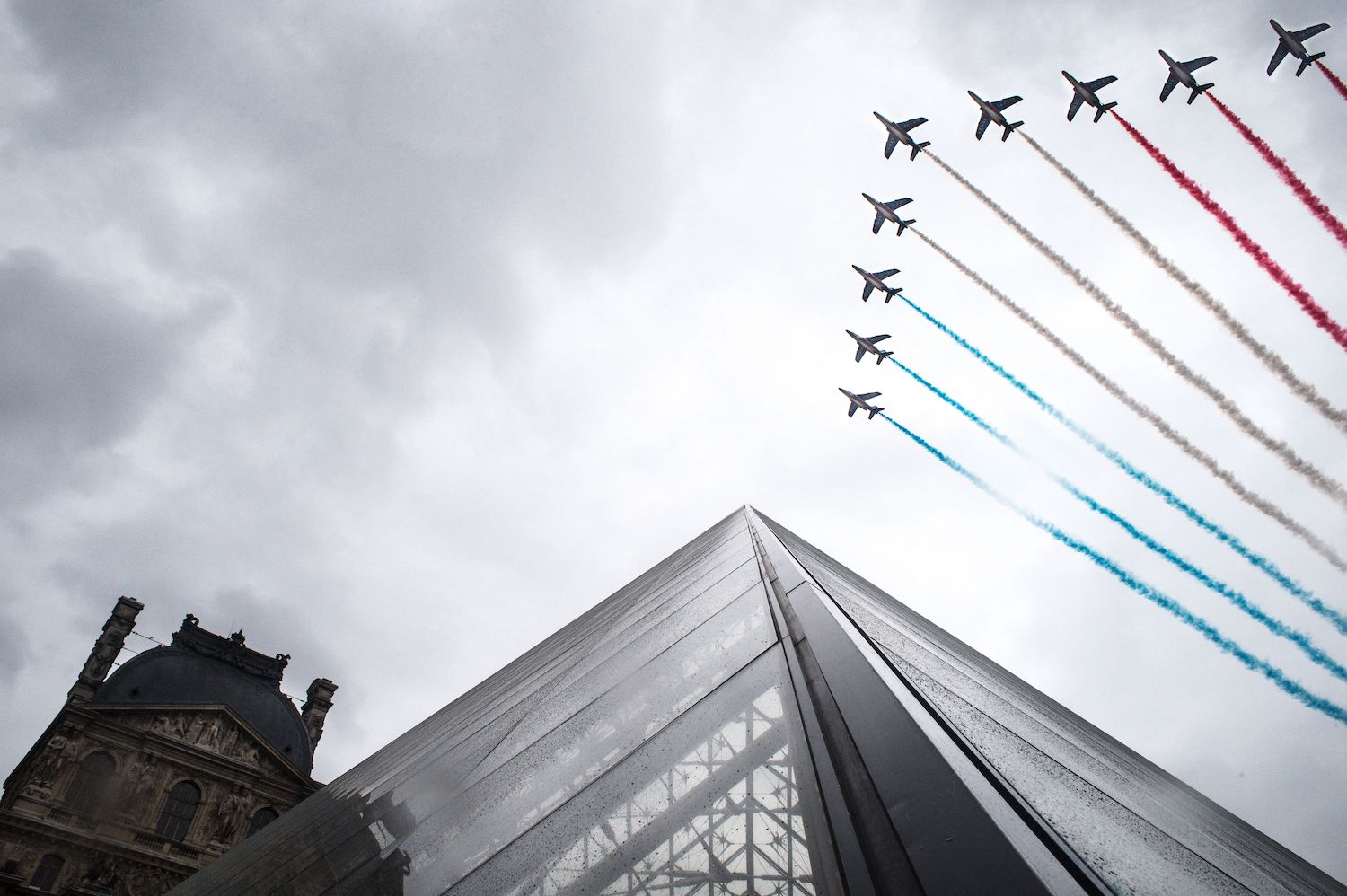 French jets fly over the Louvre Pyramid during the annual Bastille Day military parade.