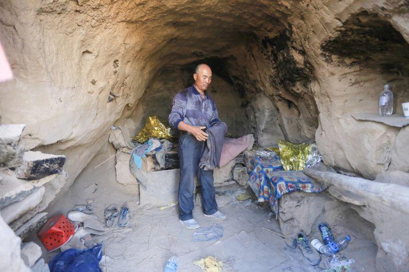 A shepherd shows where she sheltered ultramarathoners in China's Gansu province.