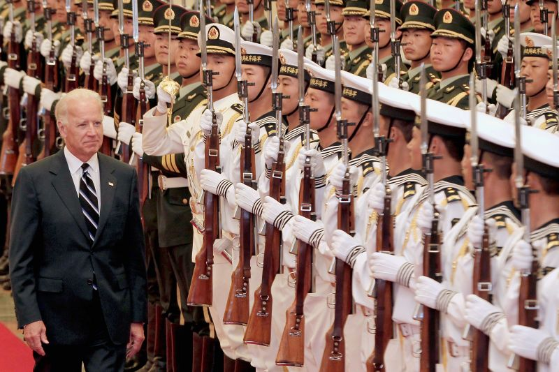 Joe Biden views an honour guard during a welcoming ceremony inside the Great Hall of the People on Aug. 18, 2011 in Beijing.