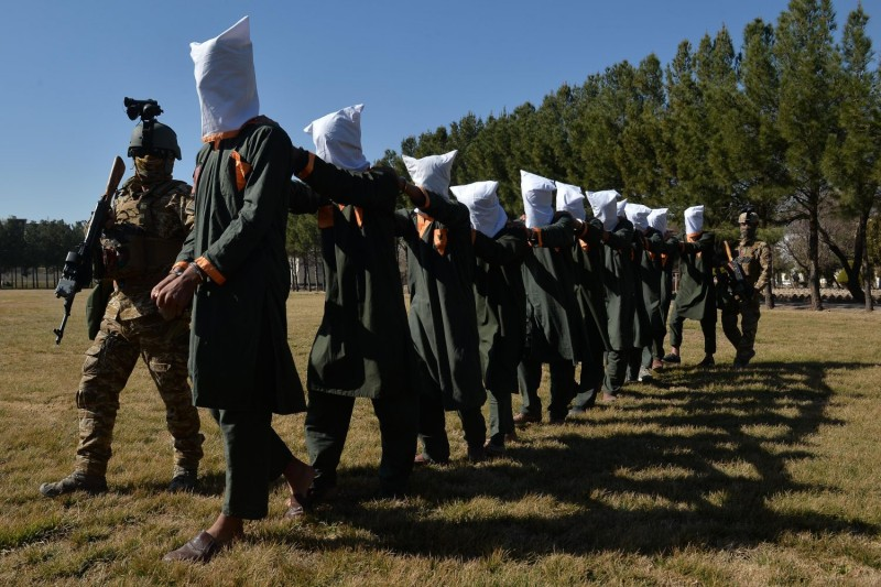 Afghan security forces escort suspected Taliban fighters
