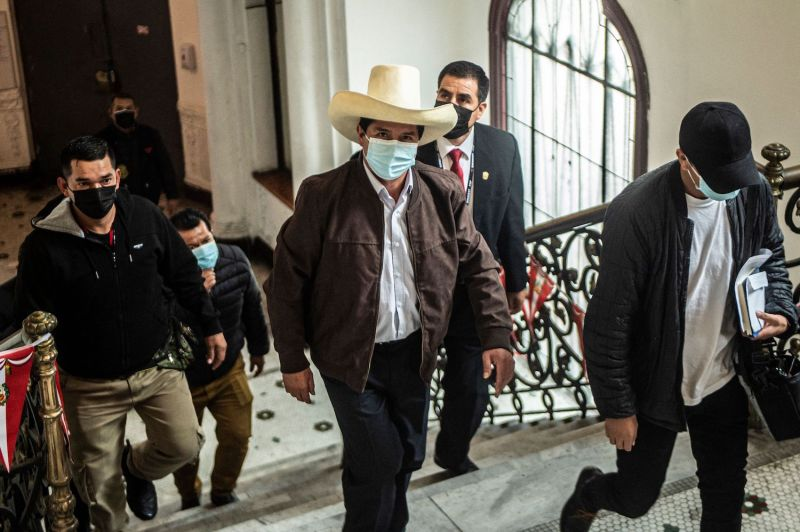 Pedro Castillo arrives for a press conference.
