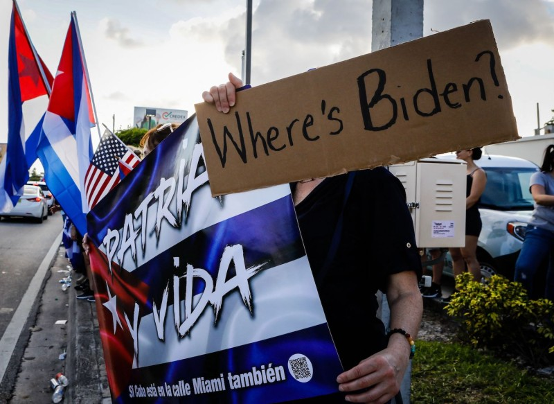 People hold Cuban and U.S. flags during a protest showing support for Cubans demonstrating against their government, in Hialeah, Florida, July 15.