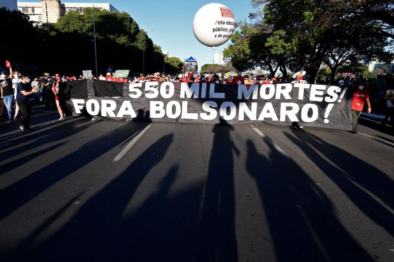 People protest the Brazilian president.