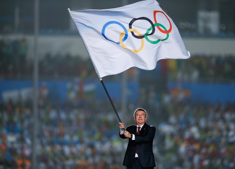 International Olympic Committee (IOC) President Thomas Bach waves the Olympic flag during the Closing Ceremony of Nanjing 2014 Summer Youth Olympic Games at the Nanjing Olympic Sports Centre on August 28, 2014 in Nanjing, China.