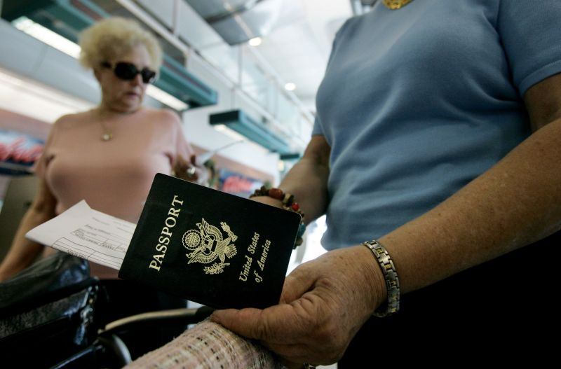 Travelers take out their passports before checking in at San Diego International Airport January 8, 2006 in San Diego, California.