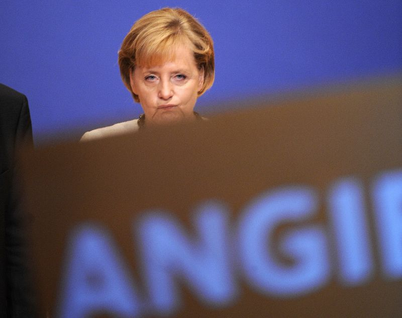 German Chancellor Angela Merkel grimaces on stage during a campaign rally on September 26, 2009 at the Treptow Arena in Berlin.