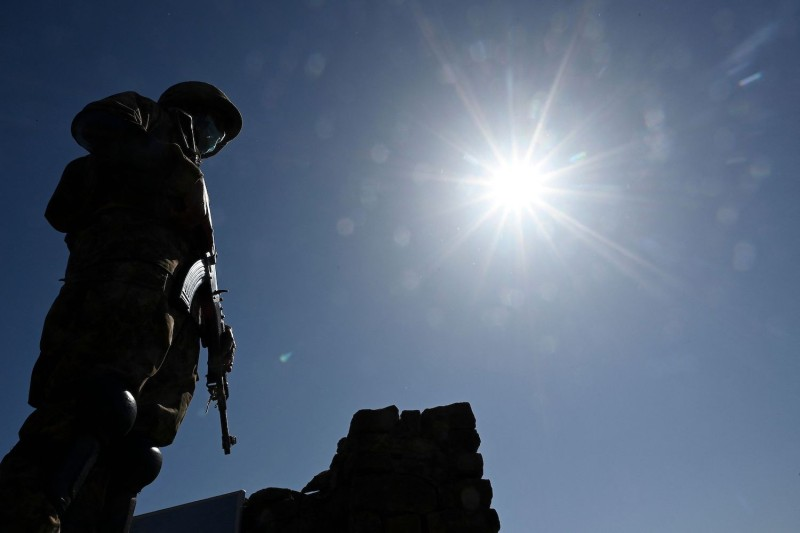 A Pakistani soldier stands guard on a post near the Line of Control in Poonch district of Pakistani-administered Kashmir on April 26.