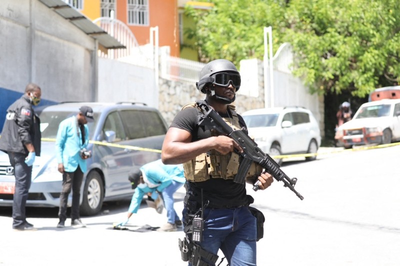 Members of the Haitian police and forensics look for evidence outside of the presidential residence in Port-au-Prince, Haiti on July 7.