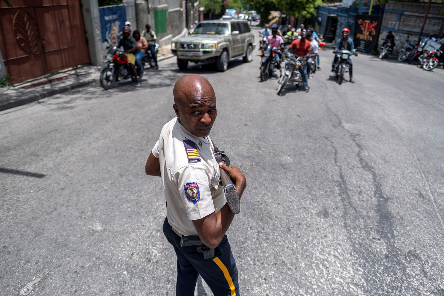 Police officer in Haiti following presidential assassination