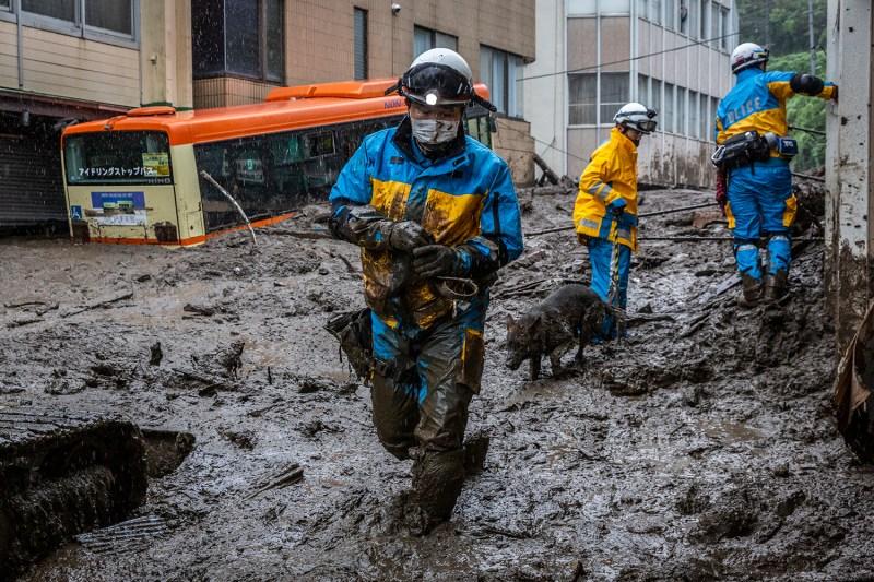 Rescuers look for people in landslide in Japan