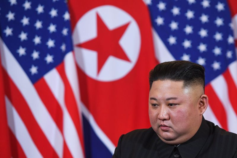 North Korea's leader Kim Jong Un listens to US President Donald Trump (not pictured) during a meeting at the Sofitel Legend Metropole hotel in Hanoi on February 27, 2019. (